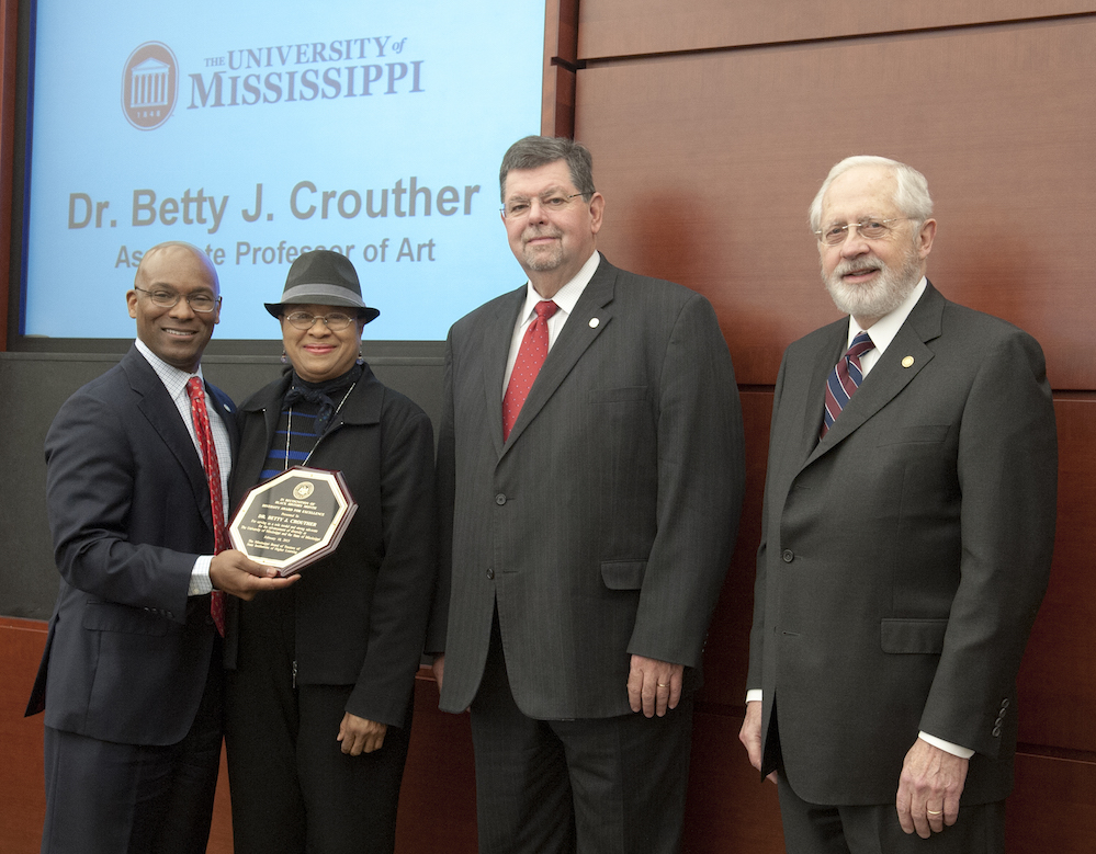Trustee Shane Hooper, Dr. Betty J. Crouther, associate professor of art, Dr. Morris Stocks, Provost, and Trustee Aubrey Patterson.