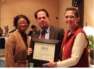 Professor Jodi Skipper (left) receives the Mississippi Historical Society award.